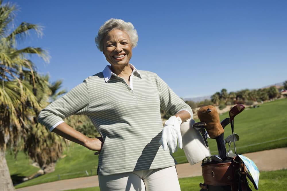 happy senior woman golfing